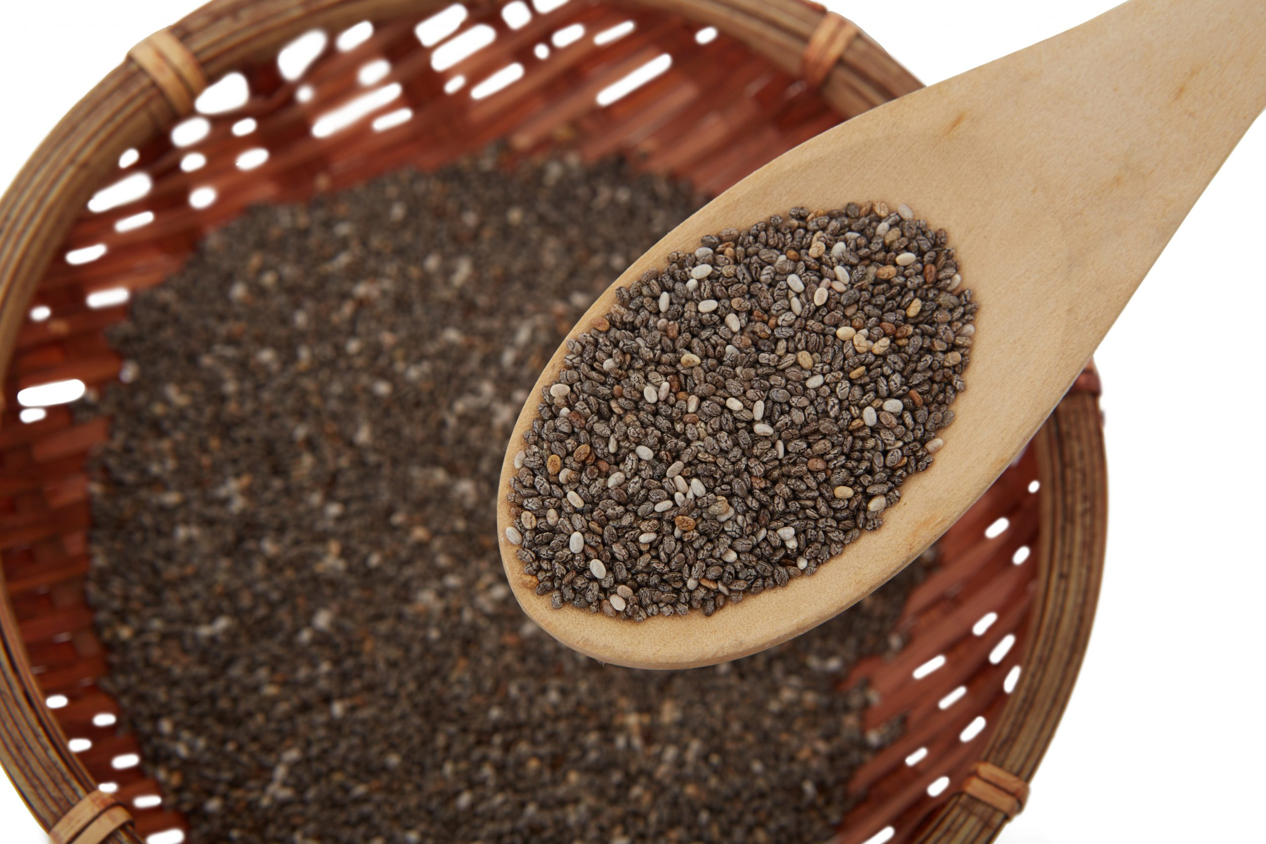 black wooden spoons having china seeds in it